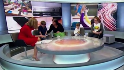 Anchor makes sweet move for nervous 6-year-old boy on live TV