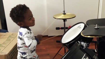 Talented 1-year old boy totally rocks out on the drums