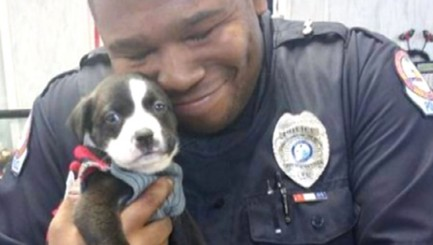 Cop's heartwarming moment with pup will make you smile