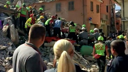 Man tries to comfort woman trapped under rubble after devastating earthquake
