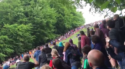 Cheese-rolling runners hurl themselves down hill