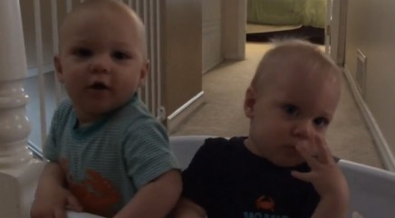 Adorable twins imitate mom