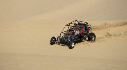 Man performs crazy dune buggy cartwheel