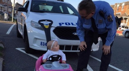Little girl gets pulled over by police while 'driving'