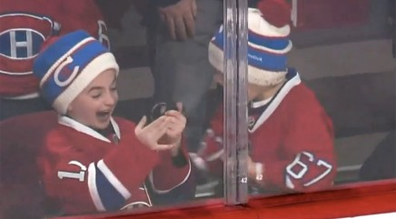 Young hockey fan flips out when player tosses him a puck