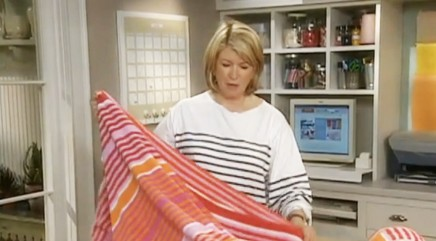 Turn a towel into a waterproof picnic blanket