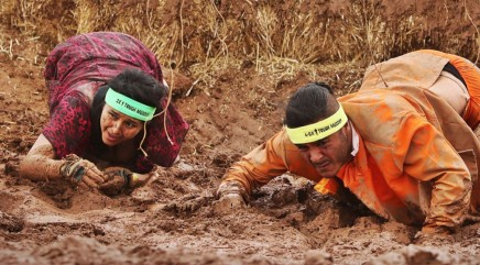 Woman gets ultimate surprise at the end of this muddy race