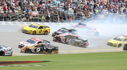 Why do NASCAR drivers exit cars on an active track?