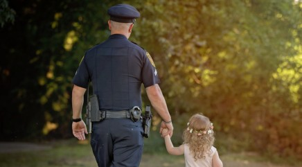 Police officer and little girl he saved from choking form incredible bond