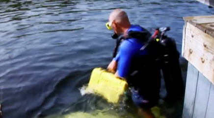 Man delivers pizza to a hotel underwater