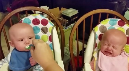 Precious twins get adorably jealous of each other