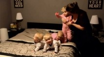 Mom's nighttime routine with wiggly infant triplets and 2-year-old caught on camera