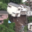 House topples over after landslide